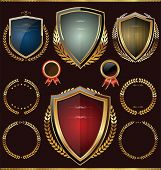 foto of shield  - Golden shields with laurels collection vector illustration - JPG