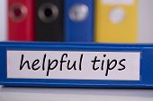 The word helpful tips on blue business binder