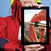 Man Sailor Showing Lifebuoy On Tablet. Sailing