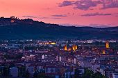City of Alba at sunset under beautiful evening sky in Piedmont, Northern Italy (view from above).