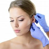 stock photo of ear  - Young woman face with beauty treatment ear plastic isolated - JPG