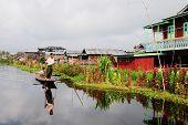 The man rowing boat on Inle lake, Myanmar