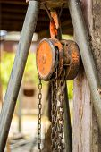 Chain Hoist With A Large Wooden Pole.