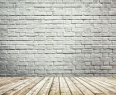 Background of age grungy white texture of paint stucco brick and stone wall with light wooden floor inside old modern and contemporary empty interior, blank color horizontal space of clean studio room