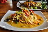 Spicy Green papaya salad (somtam) , famous Thai food
