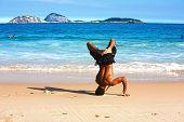 RIO DE JANEIRO, BRAZIL - MAY 13, 2007: Brazilian man dancing capoeira on Ipanema beach
