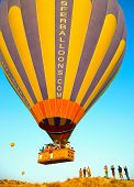 GOREME, TURKEY - AUGUST 25: Hot air balloon fly over Cappadocia on august 25, 2013 in Goreme, Cappadocia, Turkey.