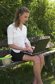 Pretty Businesswoman; Working In The Park