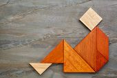 image of tangram  - abstract sitting or relaxing figure built from seven tangram wooden pieces - JPG