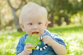 Kid On The Grass In The Park, Chewing Toy