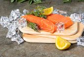 Raw Salmon Trout Fish With Fresh Thyme Herb