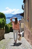 Girl on the cobbled street of Menaggio town. Lake Como, Italy