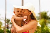 stock photo of mother baby nature  - Beautiful mother and child in the open air - JPG