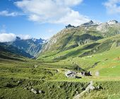 VILLE DES GLACIERS, FRANCE - AUGUST 27: Composite of Glaciers Village with chalets. The region is a stage at the Mont Blanc tour, which crosses three countries. August 27, 2014 in Ville des Glaciers.