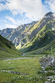 LES CHAPIEUX, FRANCE - AUGUST 27: Mountains chain with lonely chalet at the hill side. The region is