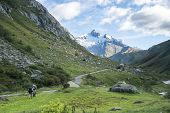 LES CHAPIEUX, FRANCE - AUGUST 27: Hikers walking with Glacier Needles in the background. The region