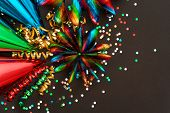 Garlands, Streamer, Party Hats And Confetti On Black