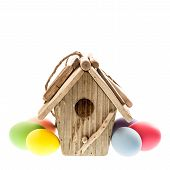 Easter Decoration With Birdhouse And Colorful Eggs