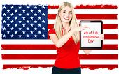 pic of independent woman  - young woman with american national flag on the background holding tablet pc with sample text - JPG