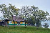 Rural landscape overcast day. House in the mountain village. Autumn mist. Carpathian, Ukraine, Europ