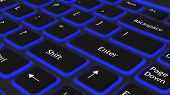 Laptop black keyboard with blue light background