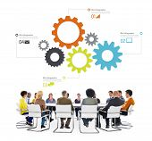 Multiethnic People in a Meeting with Infographic Symbols