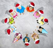 Kids with christmas hats in grey background