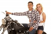 Couple Sitting On Motorcycle Close Western Serious