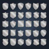 Vintage heraldic shield shapes labels design. Retro style borders, frames, labels set.