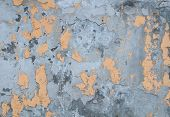 Texture Of Old Crumbling Wall With Yellow Plaster
