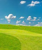 Golf Field. Beautiful Green Landscape With Blue Sky