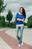 Full length portrait of a beautiful naughty brunette woman in jeans