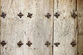 Closeup of an old wooden door in Cuenca, Castilla La Mancha, Spain.