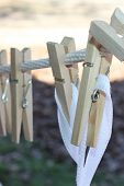 Wooden clothes pins on a rope putside