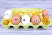 Eggs in cell egg tray on grey wooden background