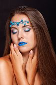 Beautiful girl with art make-up with  beads