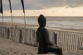 pic of budha  - Budha statue on a beach in the Netherlands - JPG