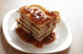 A Stack Of Pancakes With Jam Gooseberry