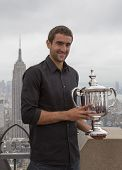US Open 2014 champion Marin Cilic posing with US Open trophy on the Top of the Rock Observation Deck