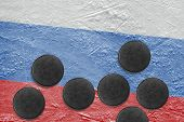 Picture of the Russian flag and washers on the ice