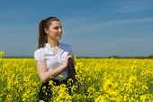 woman with a briefcase on yellow flower field