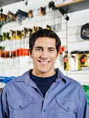 Portrait of confident male customer smiling in hardware shop