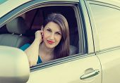 Beautiful successful woman in the passenger compartment of an expensive car
