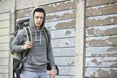 picture of homeless  - Homeless Teenage Boy On Street With Rucksack - JPG