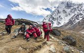 Porters with heavy load after crossing Cho La Pass in Himalayas