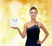 luxury, advertisement, holydays and sale concept - smiling woman with white blank shopping bag over