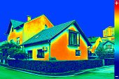 stock photo of thermal  - Infrared thermo vision image showing lack of thermal insulation on House - JPG