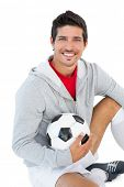 Portrait of a smiling handsome football fan over white background