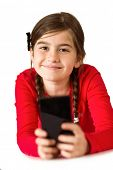 Cute little girl using smartphone on white background