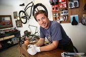 Portrait of smiling man working in bike rental shop